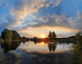 The evening river big size panorama with summer in reed on both sides of and a beautiful sunset Royalty Free Stock Photography