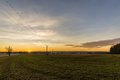 Evening scene of autumn field with sunset Royalty Free Stock Photo