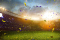 Evening stadium arena soccer field championship win confetti and tinsel yellow toning Royalty Free Stock Photo