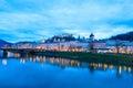 Evening twilight view of Salzburg across Salzach river in Austria Royalty Free Stock Photo