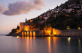 Evening view of harbour, fortress and ancient shipyard in Alanya, Turkey. Royalty Free Stock Photo