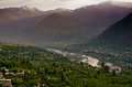 Evening view of Kulu valley with Himalaya range in Royalty Free Stock Photo
