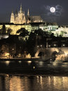 Evening view of prague castle over river and charles bridge tinted image Stock Photo