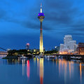 Evening view of the rheinturm tv tower in dusseldorf media harbor with and buildings neuer zollhof germany Stock Photo