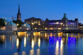 Evening view of riddarholmen island in stockholm sweden norrstrom stream vasabron bridge and with church and building Stock Photos