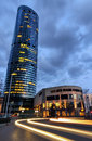 Evening view of Sky Tower office building with light auto trails Royalty Free Stock Photo