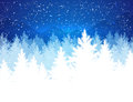 Evening winter landscape christmas with falling snow spruce forest silhouette and mountains Stock Photo
