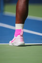 Eventeen times grand slam champion serena williams wears custom nike tennis shoes during match at us open new york august Royalty Free Stock Images