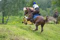 Eventer on horse negotiating the Ski jump Stock Photography