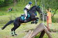 Eventer on horse is overcomes the cross-country fence Royalty Free Stock Image