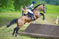 Eventer on horse is overcomes the cross-country fence Royalty Free Stock Photography