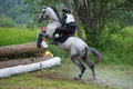 Eventer on horse is overcomes the Log fence Royalty Free Stock Photography