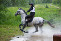 Eventer on horse is overcomes the Water jump Royalty Free Stock Image