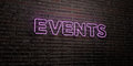 EVENTS -Realistic Neon Sign on Brick Wall background - 3D rendered royalty free stock image
