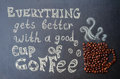 Everythink gets better with a good cup of coffee with coffee bea beans on the chalkboard toning selective focus Royalty Free Stock Photo