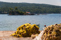 Evia island coast view of rocky with fishing nets in summer greece europe Stock Photo