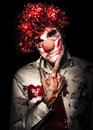 Evil Blood Stained Clown Contemplating Homicide Stock Photo