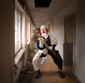Evil clown with a hammer Royalty Free Stock Photo