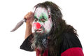 Evil clown holding a knife, isolated on white, concept horror an Royalty Free Stock Photo
