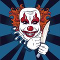 Evil clown with knife Royalty Free Stock Photo