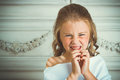 Evil emotion and smile little beautiful angel in white robe Royalty Free Stock Photography