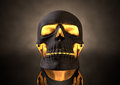 Evil glowing skull front a view of a dark human with orange insides on adark eerie background Royalty Free Stock Photos