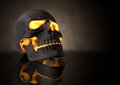 Evil glowing skull perspective a view of a dark human with orange insides on adark eerie background Royalty Free Stock Images