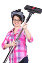 Evil housewife holding vacuum cleaner Royalty Free Stock Photography