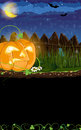 Evil jack o lantern with sprouts and leaves near the fence halloween night scene Royalty Free Stock Image