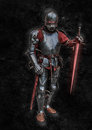 Evil knight lich dread lord with shining sword in red Stock Image