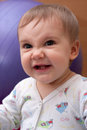 Evil smiling baby girl Stock Images