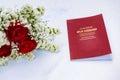Evlilik cuzdani marriage license on white table Royalty Free Stock Photo