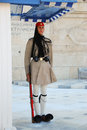 Evzones sitting on guard in front of the greek parliament at night athens greece Stock Photos