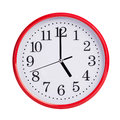 Exactly five on round clock face red Stock Images