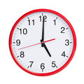 Exactly five on round clock face red Stock Image