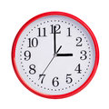 Exactly three on round clock face red Royalty Free Stock Photos