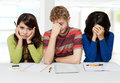 Exam fail a portrait of three stress young students sitting together after failing Royalty Free Stock Photography
