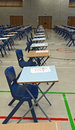 Exam tables set out in a row ready for exams Royalty Free Stock Image