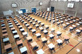 Exam time tables and chairs set up in a huge sports hall ready to be taken Stock Images