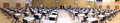 Exam time in a wide panoramic shot tables and chairs set up huge sports hall ready for exams to be taken Royalty Free Stock Images