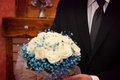 Examinig bouquet groom examining wedding photo taken in Stock Images