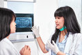 Examining teeth x ray young female dentist patient Royalty Free Stock Image