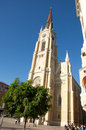 Example of monumental beautiful gothic cathedral in the central square in downtown novi sad there are buildings built in various Royalty Free Stock Images