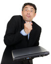 Exasperated man making a fist over his closed laptop computer which he is holding i his hand while grimacing at the camera Royalty Free Stock Images
