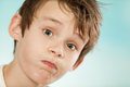 Exasperated young boy blowing out his cheeks Royalty Free Stock Photo
