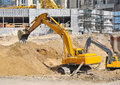 Excavating machine on construction site Royalty Free Stock Photo