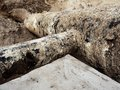 Excavation pit. Old 500mm drink water pipe with 150mm  cornering arm. Royalty Free Stock Photo