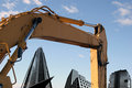 Excavator and buildings Stock Photography