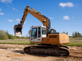 Excavator on a construction site Stock Photos