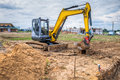 Excavator at a construction site on building ground in developing area Stock Images